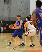 Newton South junior Chris Menz looks to dribble past Newton North senior Christian Negrotti during the game at Newton North, Dec. 27, 2018.   [Wicked Local Photo/James Jesson]