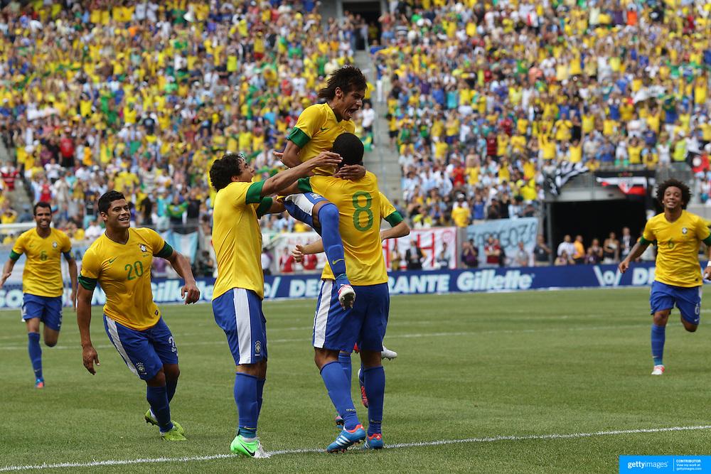 97bd4b18a Neymar jumps on Brazilian goal scorer Romulo (8) during the Brazil V  Argentina International.