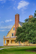 Whalehead Club , live oak, and blue sky in Corolla on the Outer Banks, NC.