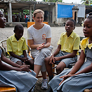 German actress Judith Hoersch meets with students at the Pyramide School in Leogane, Haiti. The school was damaged by the earthquake and CARE is supporting the school with water and sanitation programs like building latrines and hand washing stations.