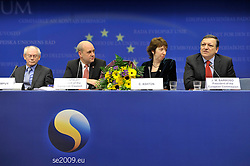 Herman Van Rompuy, Belgium's prime minister, and the first president of Europe, left, Fredrik Reinfeldt, Sweden's prime minister and standing president of the European Council, left center, sits with Catherine Ashton, Europe's new foreign minister center right, and Jose Manuel Barroso, president of the European Commission, during the press conference following the European Union Summit at the EU headquarters in Brussels, Belgium, on Thursday, Nov. 19, 2009. European leaders set divisions aside today as they chose their first-ever European Union president to represent the 27-nation bloc on the world stage. (Photo © Jock Fistick)