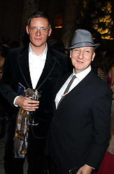 Left to right, Designer GILES DEACON and milliner STEPHEN JONES  at the 2005 British Fashion Awards held at The V&A museum, London on 10th November 2005.<br />