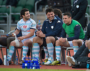 Racing 92 player DAN CARTER (R) is on the bench with team mates BRICE DULIN (L) and match captain FRANCIS VAN DER MERWE (C) for the second half of the Natixis Cup rugby match between French team Racing 92 and New Zealand team Otago Highlanders at Sui San Wan Stadium in Hong Kong.