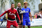 AFC Wimbledon Forward Lyle Taylor (33) in action with Watford Goalkeeper Heurelho Gomes (1) during the Pre-Season Friendly match between AFC Wimbledon and Watford at the Cherry Red Records Stadium, Kingston, England on 15 July 2017. Photo by Jon Bromley.