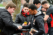 Callum Wilson (13) of AFC Bournemouth signing autographs for fans on arrival at the Vitality Stadium before the Premier League match between Bournemouth and Arsenal at the Vitality Stadium, Bournemouth, England on 14 January 2018. Photo by Graham Hunt.
