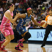 Monica Wright, (right), Minnesota Lynx, drives past Kelly Faris, Connecticut Sun, during the Connecticut Sun Vs Minnesota Lynx, WNBA regular season game at Mohegan Sun Arena, Uncasville, Connecticut, USA. 27th July 2014. Photo Tim Clayton