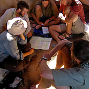 Students gather in groups to plan for independent travel days during a hiking section of their Australian Semester with the National Outdoor Leadership School,  in Drysdale National Park, Australia. Photo by Jen Klewitz