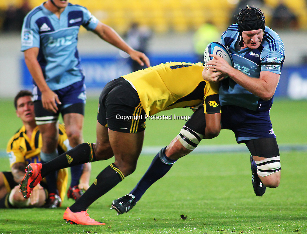 Blues' lock Ali Williams is tackled during their Super Rugby match, Hurricanes v Blues, Westpac stadium, Wellington, New Zealand. Friday 4 May 2012.  PHOTO: Grant Down / photosport.co.nz