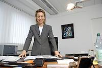 12 DEC 2005, BERLIN/GERMANY:<br /> Ursula von der Leyen, CDU, Bundesfamilienministerin, an ihrem Schreibtisch, in ihrem Buero, Bundesministerium fuer Familie, Senioren, Frauen, und Jugend<br /> Ursula von der Leyen, Federal Minister for family, Seniors, Women and Youth, in her office<br /> IMAGE: 20051212-01-020<br /> KEYWORDS: Büro