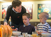 © Licensed to London News Pictures. 03/11/2014. Oxford, UK. NICK CLEGG serves local schoolchildren their breakfast.  To celebrate National School Meals Week (3-7 November), the Deputy Prime Minister, Nick Clegg, joins school children at Brasserie Blanc in Oxford to get some top cooking tips from Raymond Blanc. The visit is part of a larger national effort to raise awareness of and enhance children's relationship with food. The Deputy Prime Minister has called on celebrity chefs to lead the way by joining forces with school cooks to promote the great school lunch. School cooks up and down the country will be taking their skills out of the school kitchen to showcase to parents and pupils the variety and quality of food now being served in schools. National School Meals Week comes just months after the launch of free school meals for 2.8 million primary school children and the introduction of cooking in the curriculum.. Photo credit : Stephen Simpson/LNP