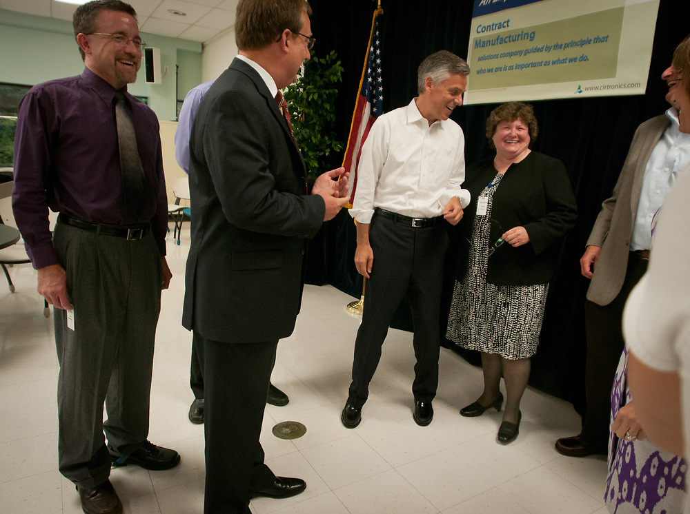 Former Ambassador to China and former Utah Gov. Jon Huntsman jokes around with Sandy Morin, company Facilitator as he tours Cirtronics, an employee owned electronic contract assembly company, Milford, NH. 2nd of August 2011.