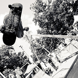 Ben Rothenhoefer, of A Way of Life skate shop, gets some air in front of Brian Haskell and company on the Skatepark of Baltimore halfpipe.