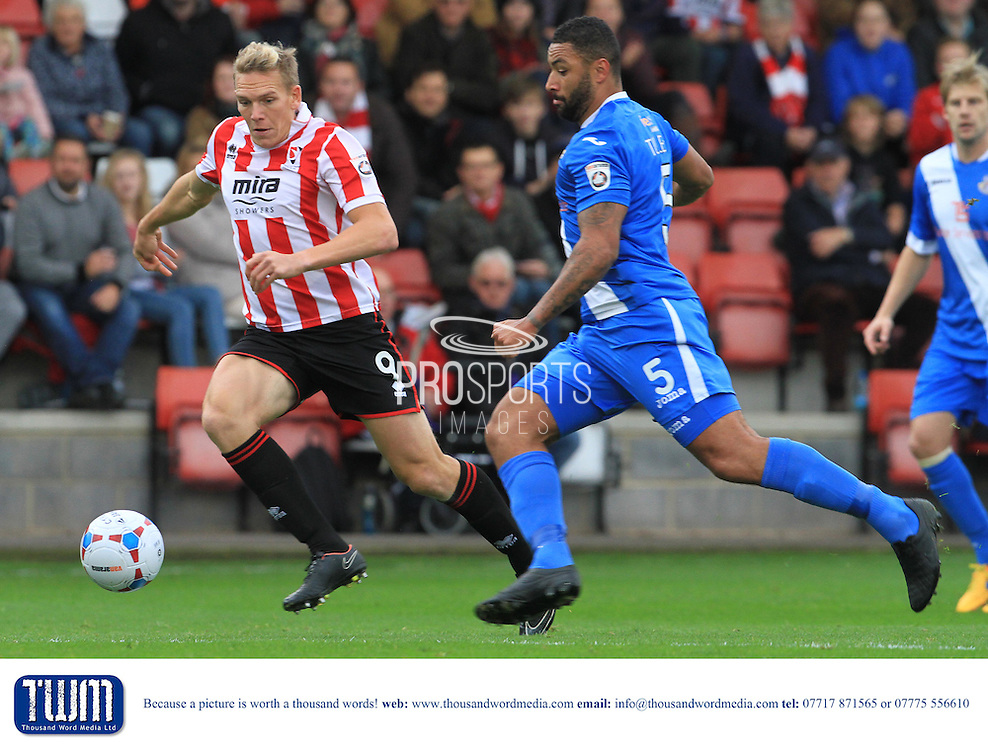 Danny Wright and Jamie Turley during the Vanarama National League match between Cheltenham Town and Eastleigh at Whaddon Road, Cheltenham, England on 17 October 2015. Photo by Antony Thompson.