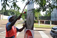 Youth Corps' D'Marius Deberry cleans traffic signs in Oxford, Miss. on Tuesday, June 25, 2013.