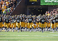 September 21 2013: The Iowa Hawkeyes take the field in The Swarm before the start of the NCAA football game between the Western Michigan Broncos and the Iowa Hawkeyes at Kinnick Stadium in Iowa City, Iowa on September 21, 2013. Iowa defeated Western Michigan 59-3.