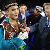 "Kanat ""QazaQ"" Islam of Almaty, Kazakhstan speaks to the media after defeating Noroberto ""Demonio"" Gonzalez of Monterrey, Mexico to win the NABO Jr. Middle Weight Title during a Nelsons Promotions boxing match at the Boca Raton Resort  and Club on Friday, May 26, 2017 in Boca Raton, Florida.  (Alex Menendez via AP)"