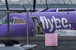 © Licensed to London News Pictures. 05/03/2020. London, UK. A worker secures a flybe aircraft as it sits on the tarmac at London's Heathrow airport. Airline 'flybe' has collapsed after financial difficulties exacerbated by a drop in business due to the COVID-19 coronavirus outbreak. Photo credit: Peter Manning/LNP