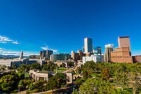 Downtown Denver skyline with City & County Bldg. on left and Civic Center Park in foreground, Denver, Colorado USA.