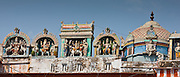 Hindu religious icons above Hindu Temple at Kedar Ghat during Festival of Shivaratri in holy city of Varanasi, Northern India