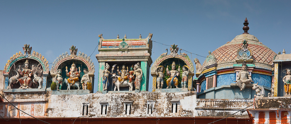 Hindu religious icons above Hindu Temple at Kedar Ghat during Festival of Shivaratri in holy city of Varanasi, Northern India