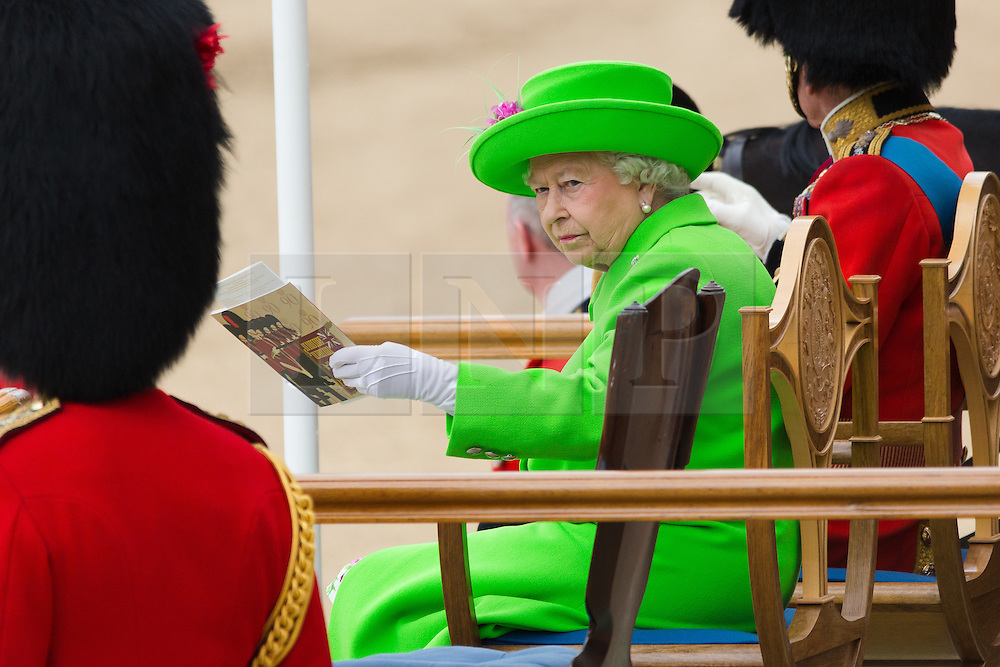 © Licensed to London News Pictures. 11/06/2016. LONDON, UK.  Queen Elizabeth II at Trooping the Colour ceremony in Horse Guards parade. Around 1,500 soldiers take part in the annual Trooping of the Colour ceremony, which this year celebrates the 90th birthday of Her Majesty Queen Elizabeth II.  Photo credit: Vickie Flores/LNP