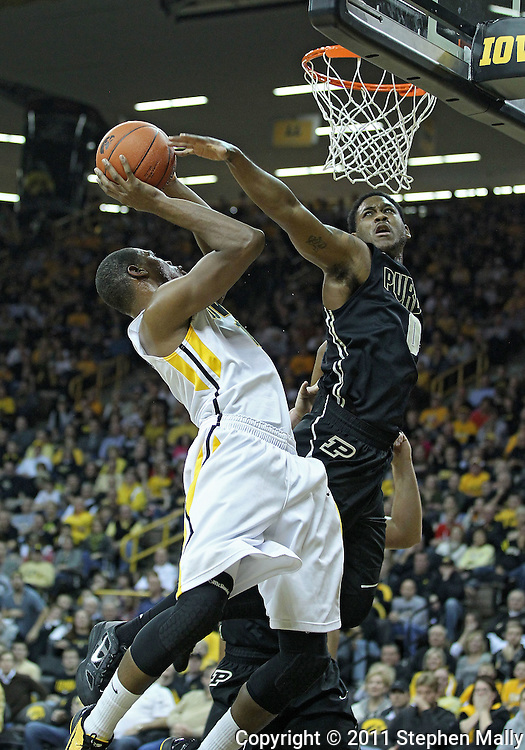 December 28, 2011: Purdue Boilermakers guard Terone Johnson (0) tries to block a shot by Iowa Hawkeyes forward Melsahn Basabe (1) during the NCAA basketball game between the Purdue Boilermakers and the Iowa Hawkeyes at Carver-Hawkeye Arena in Iowa City, Iowa on Wednesday, December 28, 2011. Purdue defeated Iowa 79-76.