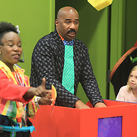 Steve Harvey plays a quiz game against Foley Buse, 6, of Tupelo, led by Angela Brown, left, a health educator at HealthWorks during Harvey's visit to HealthWorks Friday afternoon in Tupelo.