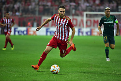 September 20, 2018 - Piraeus, Attiki, Greece - Kostas Fourtounis (no 7) of Olympiacos, controls the ball by avoiding Joacquin (no 17) of Real Betis. (Credit Image: © Dimitrios Karvountzis/Pacific Press via ZUMA Wire)