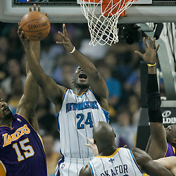 April 24, 2011; New Orleans, LA, USA; New Orleans Hornets power forward Carl Landry (24) is fouled by Los Angeles Lakers small forward Ron Artest (15) during the first quarter in game four of the first round of the 2011 NBA playoffs at the New Orleans Arena.    Mandatory Credit: Derick E. Hingle