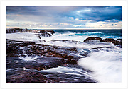 Wave action over the rock platforms near Mahon Pool [Maroubra, NSW, Australia]<br />