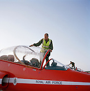 Members of the Blues, th 'Red Arrows', Britain's Royal Air Force aerobatic team support crew, wipe away morning moisture.