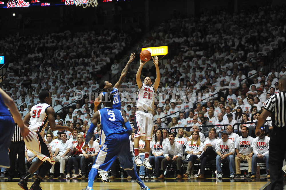 """Ole Miss' Marshall Henderson (22) shoots against Kentucky's Archie Goodwin (10) at the C.M. """"Tad"""" Smith Coliseum on Tuesday, January 29, 2013."""