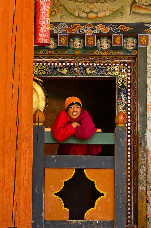 Buddhist monk at monastery, Ura Valley, Bumthang Valley, Bhutan