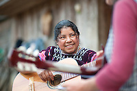 The muscian Darlene teaches a Yaxgemel community member the guitar in Chiapas, Mexico February 2009. She was invited by Chris Treter of Higher Grounds Trading Company to particpate in the Music for CHiapas project.