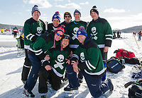 The Irish Flu team from Franklin, MA were 0 for 2 on Friday but that didn't dull their enthusiasm as they look forward to Saturday's game against the Fat Pucks in the Twig Division during the New England Pond Hockey Classic on Meredith Bay.  (Karen Bobotas/for the Laconia Daily Sun)