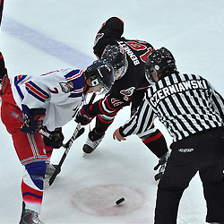 COBOURG, ON - Oct 12 : Ontario Junior League Game Action between, Milton Icehawk's Hockey Club and the North York Ranger's Hockey Club at the OJHL Governors Showcase Tournament. #18 Shan Bennett of the Milton Icehawks takes the face-off against #7 Adam Valadao of the North York Ranger's.(Photo by Jennifer-Rose DeVincentis / OJHL Images