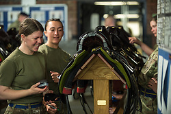 © London News Pictures. 14/07/2015.  Gunners from Kings Troop Royal Horse Artillery make the finishing touches to their kit. . More usually associated with the ceremonial gun salutes and musical rides with their 13lb guns, they took on the role of both mounted and dismounted guard at the entrance of Horse Guards. This year, for the first time, they are using Knightsbridge Barracks, the home of the Household Cavalry Mounted Regiment, for the period of their duty, as opposed to Wellington Barracks, which they have used in previous years.  Photo credit: Sergeant Rupert Frere/LNP