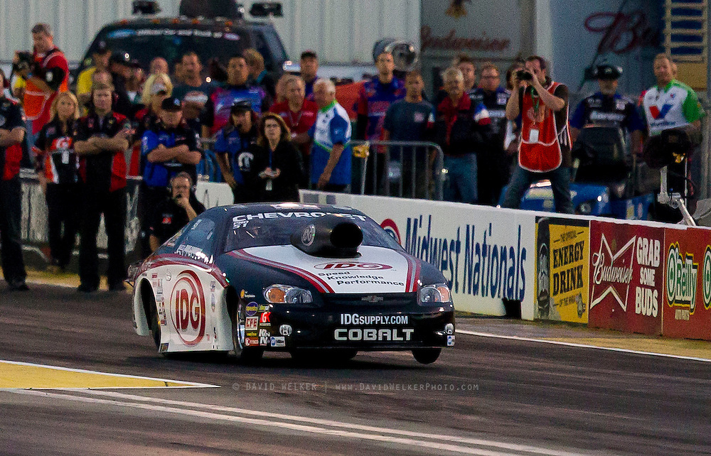 Pro Stock driver Dave Connolly  launches his IDG Cobalt off the starting line during the NHRA Midwest Nationals at Gateway Motorsports Park on September 28, 2012 in Madison, IL. (David Welker/www.Turfimages.com).