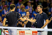 Leon Smith, team captain of Great Britain congratulates Jamie Murray of Great Britain after a successful esrvice game during the 2016 Davis Cup Semi Final between Great Britain and Argentina at the Emirates Arena, Glasgow, United Kingdom on 17 September 2016. Photo by Craig Doyle.