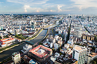 A view over Saigon and one of the river's tributaries from Bitexco Tower's sky deck in downtown Ho Chi Minh City, Vietnam.