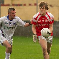 Éire Óg's Shane O'Donnell pushed by Clann Lir's Rohan Rafferty