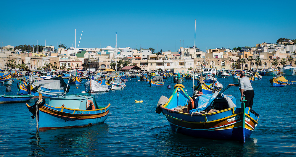 A traditional fishing boat (Luzzu) arriving at Marsaxlokk's harbour.