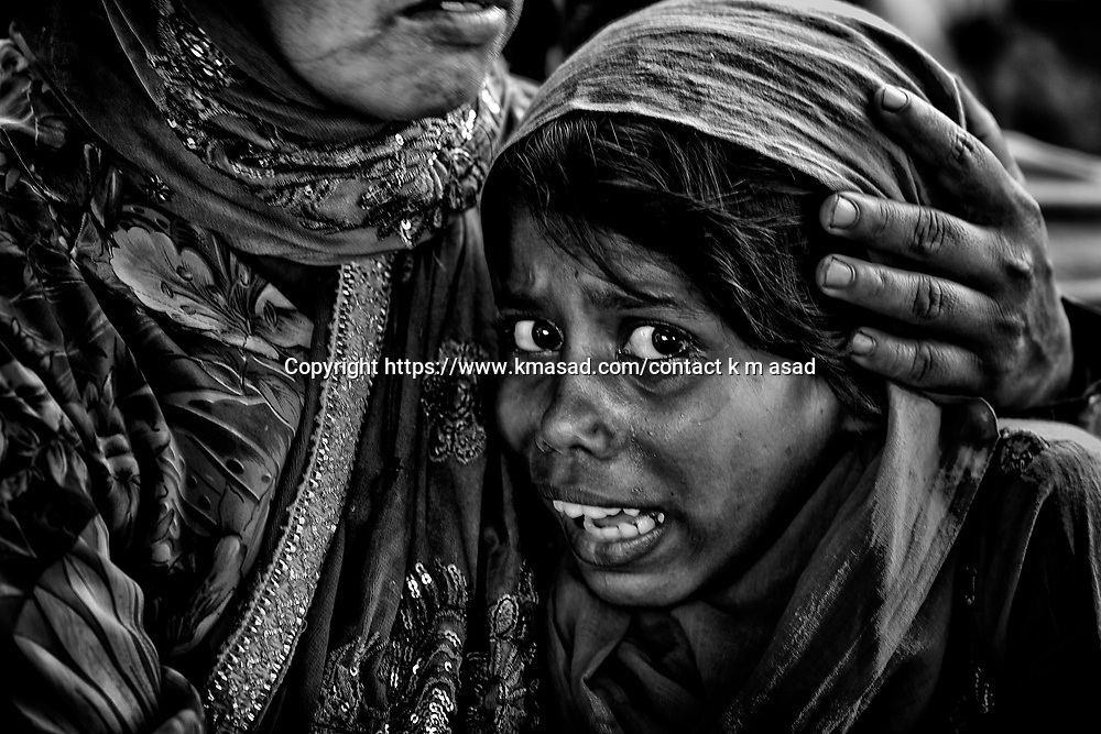 Poly 12 years old girl scared to saw his mother death body, which found in the Collapse building Rana Plaza in Savar, Near Dhaka on 10 May Bangladesh.