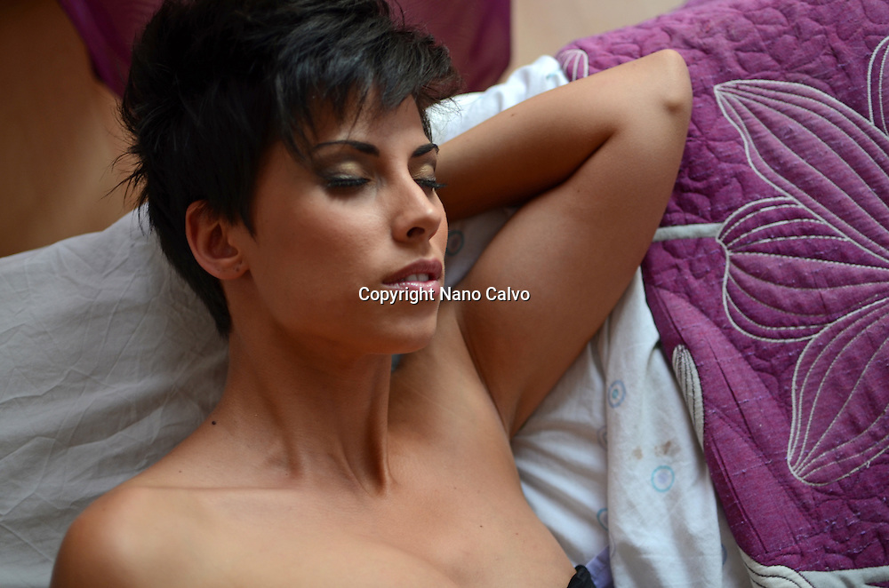Attractive short haired woman falls asleep in bed after party