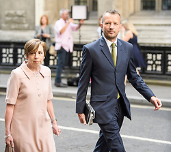 © Licensed to London News Pictures. 18/07/2018. London, UK. FRAN UNSWORTH (left), Head of BBC News, and JONATHAN MUNRO (right), Head of Newsgathering arrive at the Rolls Building of the High Court in London where judges will deliver their decision on a claim by Sir Cliff Richard for damages against the BBC for loss of earnings. The 77-year-old singer is suing the corporation after his home in Sunningdale, Berkshire was raided following allegations of sexual assault made to Metropolitan Police. Photo credit: Ben Cawthra/LNP
