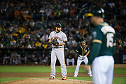 San Francisco Giants relief pitcher George Kontos (70) pitches against the Oakland Athletics at Oakland Coliseum in Oakland, California, on July 31, 2017. (Stan Olszewski/Special to S.F. Examiner)