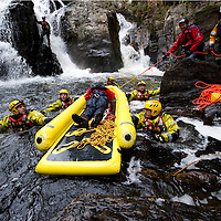 Tayside Fire & Rescue Water Rescue Exercise, The Hermitage, Dunkeld, Perthshire...04.05.10<br /> Record reporter James Moncur (bottom right) with members of Tayside Fire & Rescue, Tayside Mountain Recue and Tayside Police Search & Rescue guide the Rescue Sled down the River Braan with the casulaty on board, pictured clockwise from left, Dave Lees, Rob Green, Jim Roberts, Terry Walker all Firefighters from Red Watch Dundee Kingsway Station.<br /> Picture by Graeme Hart.<br /> Copyright Perthshire Picture Agency<br /> Tel: 01738 623350  Mobile: 07990 594431