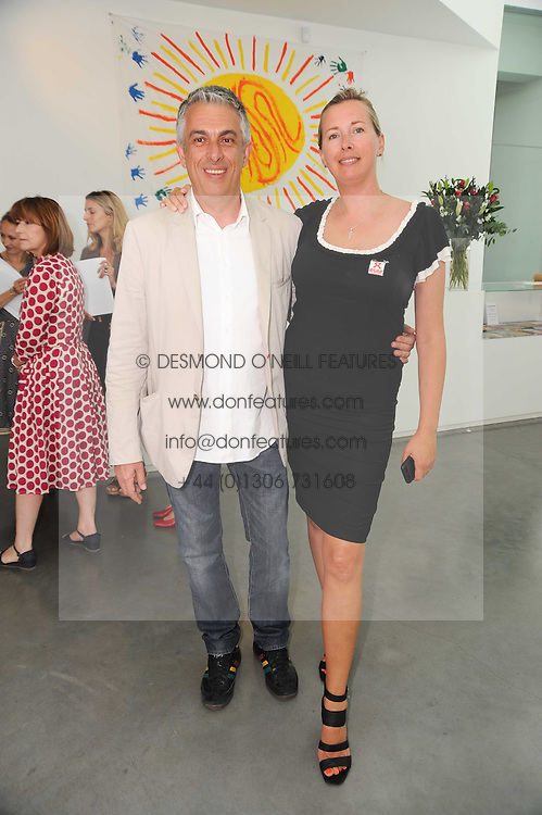 Left to right, RIFAT OZBEK and TIGGY KENNEDY at a charity lunch organised in aid of ASAP (African Solutions to African Problems) held at the Louise T Blouin Foundation, 3 Olaf Street, London W11 on 23rd June 2010.