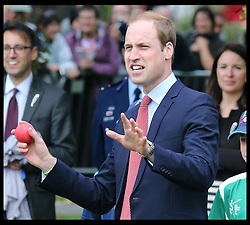 The Duke of Cambridge bowls to his wife the Duchess of Cambridge  during a cricket match  with schoolchildren in Christchurch, New Zealand,  Monday, 14th April 2014. Picture by Stephen Lock  / i-Images