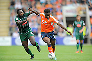 Plymouth Argyle's David Ijaha (22)  and Luton Town midfielder Pelly Ruddock Mpanzu (17) during the EFL Sky Bet League 2 match between Plymouth Argyle and Luton Town at Home Park, Plymouth, England on 6 August 2016. Photo by Graham Hunt.